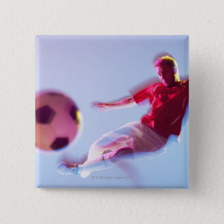 Blurred view of soccer player kicking ball pinback button