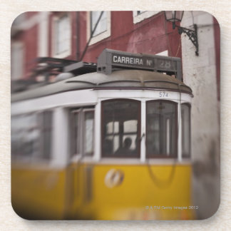 Blurred view of streetcar on city street beverage coaster