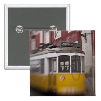 Blurred view of streetcar on city street pinback button