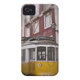 Blurred view of streetcar on city street iPhone 4 case