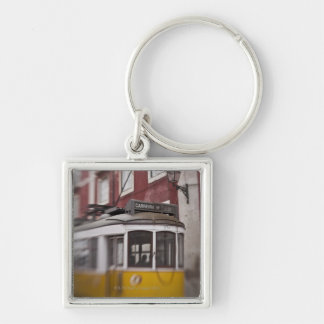 Blurred view of streetcar on city street keychains