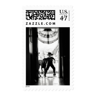 Blurred young boy and dog on porch postage
