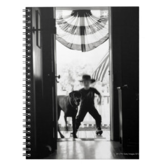 Blurred young boy and dog on porch spiral notebook