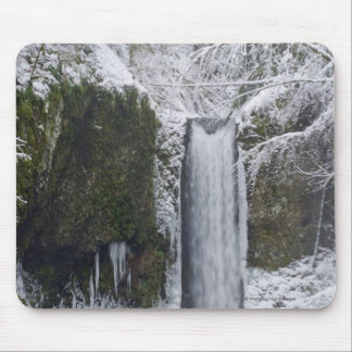 Blurry Waterfall Surrounded by a Snowy Forest Mouse Pad