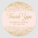 "Blush Pink Faux Gold Glitter Wedding Thank You Classic Round Sticker<br><div class=""desc"">Personalize your wedding favors with these blush pink and faux gold glitter thank you stickers. Designs are flat printed illustrations/graphics - NOT ACTUAL GOLD GLITTER</div>"