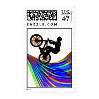 BMX en el camino del arco iris Sello
