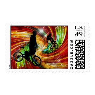 BMXers in Red and Orange Grunge Swirls Postage