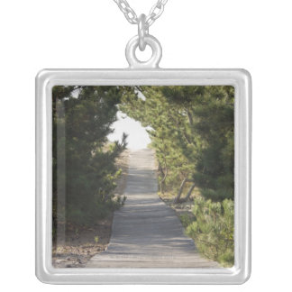 Boardwalk footpath through evergreen silver plated necklace