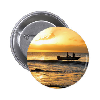 Boat at sunset button