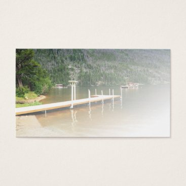 Beach Themed boat dock on a lake by a mountain business card