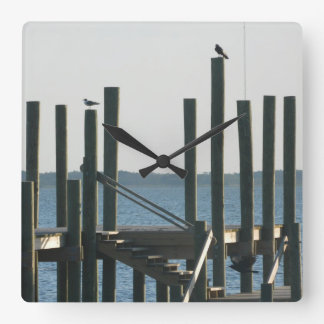 Boat Docks at Dusk Square Wall Clock