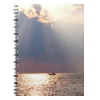 boat in florida sunrise over ocean notebook