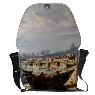 Boat in the beach messenger bag