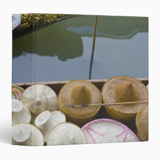 Boat loaded with bamboo hats at floating market binder