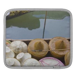Boat loaded with bamboo hats at floating market iPad sleeve