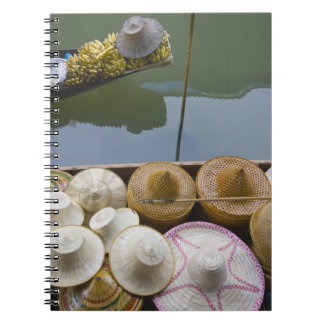 Boat loaded with bamboo hats at floating market notebook