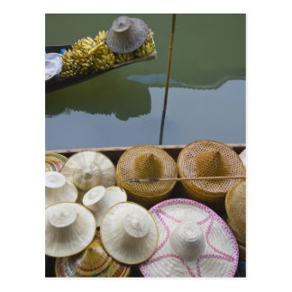 Boat loaded with bamboo hats at floating market postcard