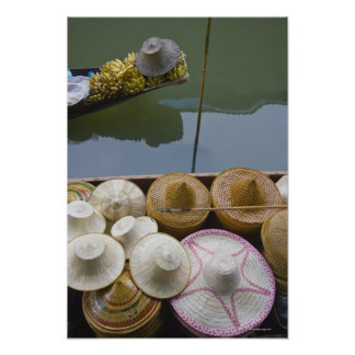 Boat loaded with bamboo hats at floating market poster
