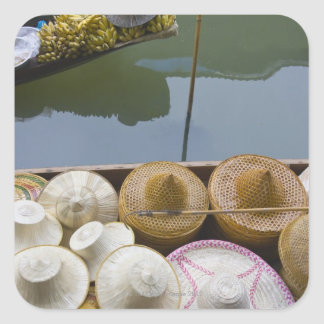 Boat loaded with bamboo hats at floating market square sticker