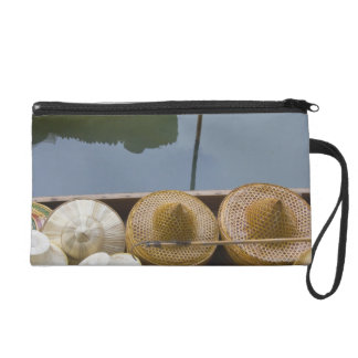 Boat loaded with bamboo hats at floating market wristlet purse