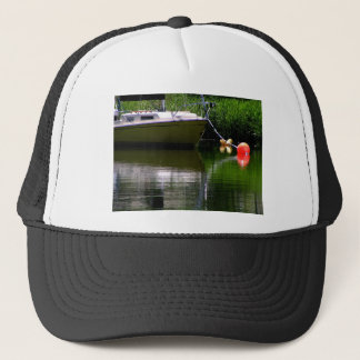 Boat moored at the lake trucker hat