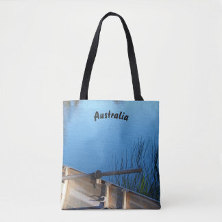 Boat on the lake tote bag