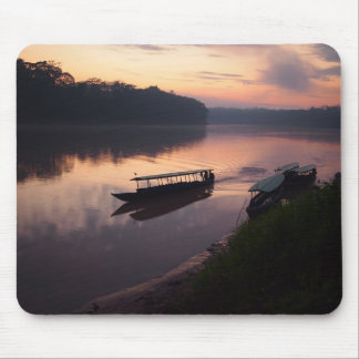 Boat on the river in Amazon rainforest mousepad