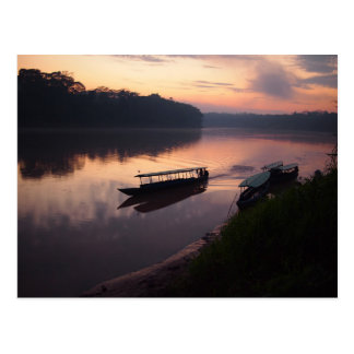 Boat on the river in Amazon rainforest postcard