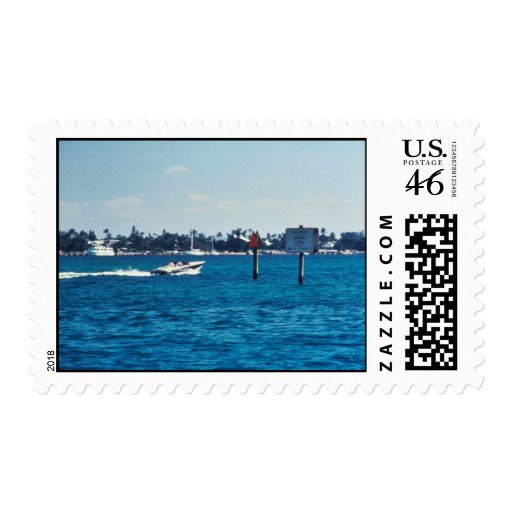 Boat speeding through manatee idle zone postage stamp