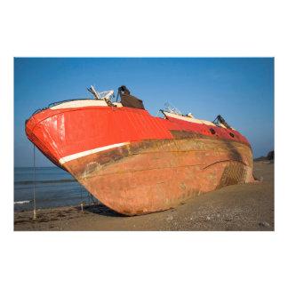 Boat stranded on the beach of Mutriku Cojinete