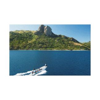 Boat with tourists approaching Waya island Canvas Print