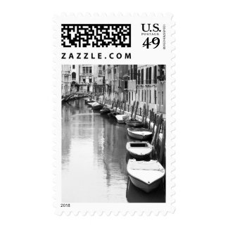 Boats along a canal in the Italian city of Venice Postage