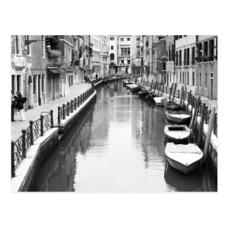 Boats along a canal in the Italian city of Venice Postcard