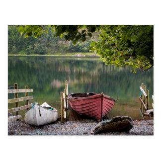 Boats along the shore of Buttermere Lake Postcard