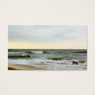 Boats and surge from the border of the beach business card