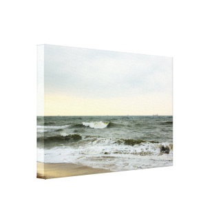 Boats and surge from the border of the beach canvas print