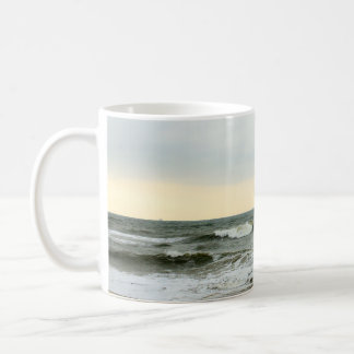 Boats and surge from the border of the beach coffee mug