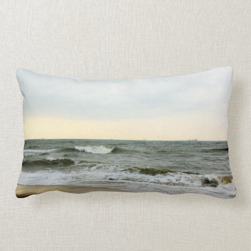 Boats and surge from the border of the beach pillows