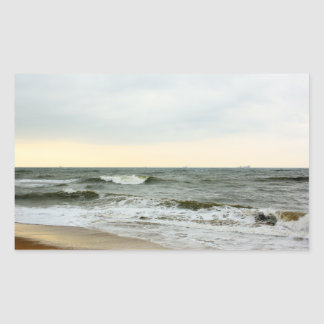 Boats and surge from the border of the beach rectangular stickers