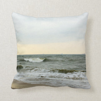 Boats and surge from the border of the beach throw pillow