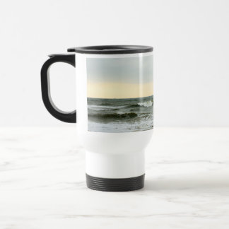 Boats and surge from the border of the beach travel mug