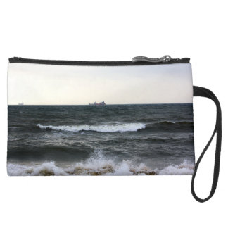 Boats and Surge in the Atlantic Ocean from the coa Suede Wristlet Wallet