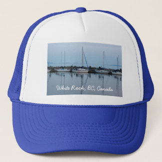 boats by the beach trucker hat