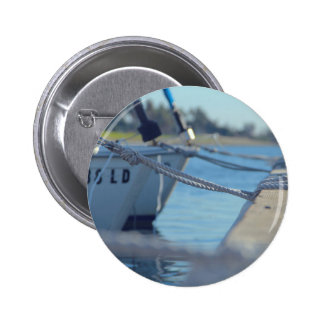Boats docked at a wooden dock 2 inch round button