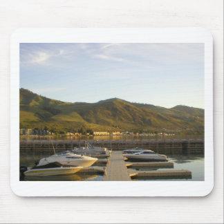 Boats docked on lake mouse pad