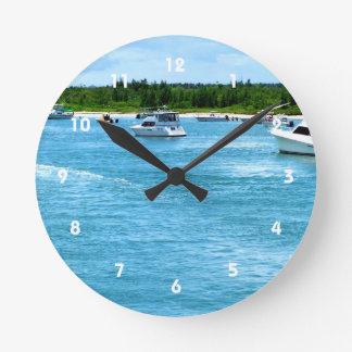 boats going out to sea in Florida Round Wall Clock