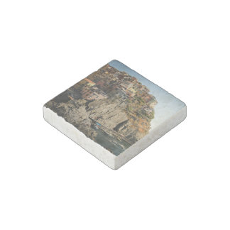 Boats in harbor and houses on the hill stone magnet