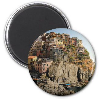 Boats in harbor and houses on the hill 2 inch round magnet
