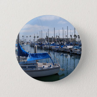 Boats in harbor button