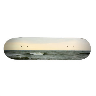 Boats in the sea and waves in the border of the be skateboard deck